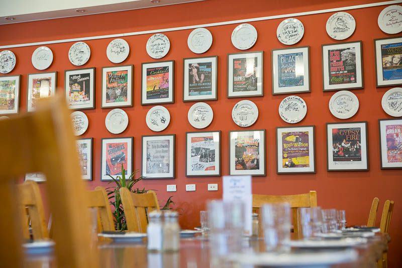 Plates and tour posters on the wall